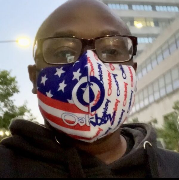 Loupy D wearing red white and blue protective velour mask with filters